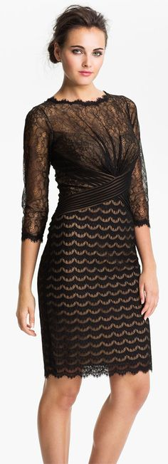 Tadashi Shoji Illusion.    Different  fabrics and patterns make this classic black dress stand out.