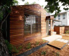 Zeitgemässe Fassadensysteme-Holzlatten-Paneele bieten Sonnenschutz