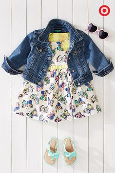 Your little girl will look darling at the Easter egg hunt when she rocking this outfit. Top her sweet, butterfly-print dress with the denim jacket. Pastel, bow-trimmed sandals and fun, heart-shaped shades complete the eggs-tremely adorable look.