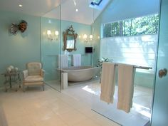 This long island en suite designed by Vincente Wolf achieves an aqueous quality of being underwater through the seafoam green glass walls. A mix of touches from the past with modern elements creates a unique space that is contemporary, yet timeless.