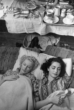 Sonia and Wenda, showgirls at the Windmill theatre, asleep in their dressing room under new rules for the dancers, lights out at 11. The girls dance for 6 hours then sleep on the floor of their dressing room as they eat sleep and work at the theatre, 19th October 1940. Original Publication : Picture Post - 316 - Backstage - pub. 1940. (Photo by Picture Post/Hulton Archive/Getty Images)