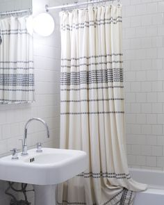 Buy shower curtain here: https://www.coyuchi.com/organic-cotton-rippled-stripe-shower-curtain.html