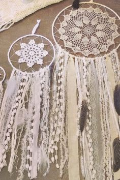 dream catcher; white and cream lace and natural feathers...