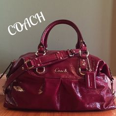 """Coach Ashley Patent Leather Satchel Perfect Condition!!!  The largest Ashley. Beautiful Red color w/ polished silver hardware. Coach logo on front and hang tag. Zip closure with leather pull. Dual rolled handles also removable shoulder strap w/10"""" drop and can be tucked away bottom of bag. Protective metal feet. Interior Burgundy color sateen fabric with 1 zip pocket and 2 slip pockets.  Measures 15""""X11.5""""x7""""  large bag!!!  Maybe used a total of 3 hrs!!!  Retail $498 Coach Bags Satchels"""