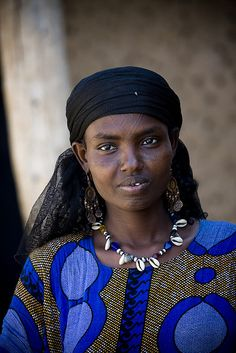 Woman with scarifications on the face, Assaita, Danakil, Ethiopia by Eric Lafforgue, via Flickr