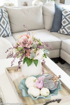 2017 Fall Home Tour with shades of mauve and blue. Faux flowers can be the perfect touch for your coffee table!