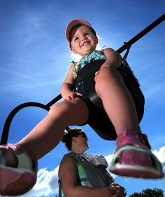18 month old Parker White of Marlborough waits in her swing for her mother, Kristen, who forgot to push her while talking with another park patron at Ghiloni Park in Marlborough.