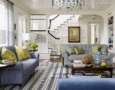 Hampton-style living room....love all the blue and white, green accents, beautiful of the staircase.