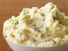 Tangy Mashed Potatoes (No. 3) : Cover 2 pounds whole russet or Yukon gold potatoes with cold salted water; simmer 45 minutes. Drain, peel and mash with 1/2 to 1 stick butter. Add 1 cup 1 cup sour cream, and salt and pepper; mash until smooth and fluffy. Top with fresh dill.