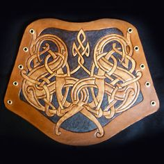 Hand Carved Leather Archery Bracer, Armguard Celtic Dogs Design LARP | eBay   http://www.ebay.co.uk/itm/Hand-Carved-Leather-Archery-Bracer-Armguard-Celtic-Dogs-Design-LARP-/321326134244?pt=UK_Archery&hash=item4ad087b3e4
