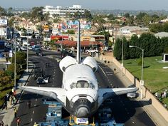 Spectators watch as Endeavour arrives at the Forum in Inglewood, Calif., on Saturday. The shuttle is making its way through Los Angeles to the California Science Center via USA Today