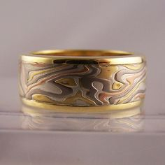 etched mokume gane rings with yellow gold rails #jewellery #jewellerydesign #jewelleryonline #jewelleryset #jewelleryshops #bespoke #asschercut #diamond #diamondrings #style #sapphire #emerald #emeraldring #sapphirering #wedding #weddingrings