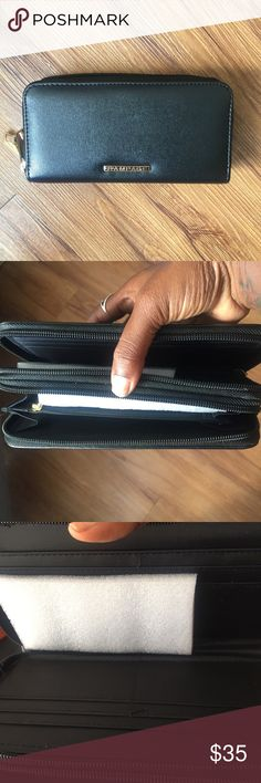 🎀NWOT black Rampage wallet🎀 NWOT black Rampage wallet. It has double slots and plenty of room for credit cards, cash, coins, etc. My kind of wallet!!!   -9 1/2 by 4 inches Rampage Bags Wallets