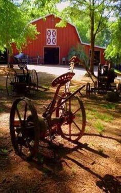 Old farm equipment - I love red barns!