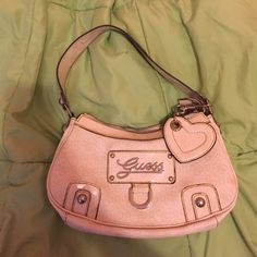 GUESS bag with FREE Ring Guess purse. Great condition. Clean inside and out. Guess Bags