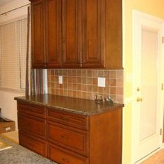 Kitchen Remodel with Dark Cherry Cabinets with Black Glaze and HD Laminate Tops by Hatchett Design/Remodel