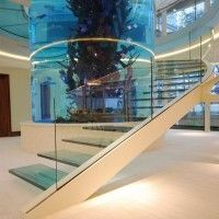 I am going to have an aquarium as a wall for my master bath shower. dibs on the idea!