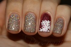 Gold glitter nails and a red nail with a white snowflake design. #nailart #Christmas