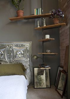 DIY - headboard out of tin ceiling tiles and shelving out of pipe
