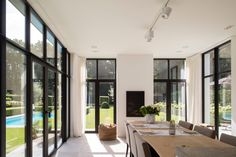 All the windows, dining nook Style At Home, Interior Architecture, Interior And Exterior, Indoor Outdoor Fireplaces, Dining Room Inspiration, Modern Country, Glass House, House Goals, Interior Design Living Room