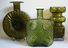 Aurinko Sun vase by  Helena Tynell.  Grapponia vase by Nanny Still. Kehra vase by Tamara Aladin.