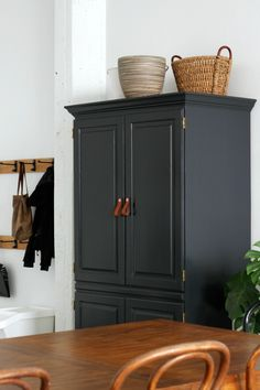 Large armoire painted with Tricorn Black from Sherwin Williams. Large armoire painted with Tricorn Black from Sherwin Williams. Leather Pulls transform it to Armoire En Pin, Tv Armoire, Antique Armoire, Armoire Wardrobe, Wardrobe Handles, Shaker Furniture, Painted Furniture, Bedroom Furniture, Bedroom Decor