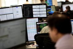 FILE PHOTO: Traders looks at financial information on computer screens on the IG Index trading floor LONDON (Reuters) - Britain's markets Monetary Policy, Exchange Rate, Investment Companies, Financial Information, Market Price, Financial Markets, How To Raise Money, Britain, Meant To Be