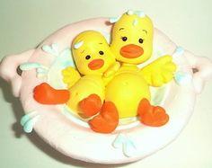 Topo de bolo Patinhos na água em biscuit