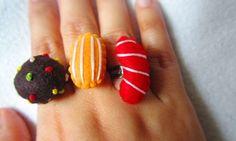 candy crush rings...red jellybean / orange lozenges / colorbomb...felt plushies Jelly Beans, Plushies, Felt, Candy, Orange, Felting, Stuffed Toys, Jelly