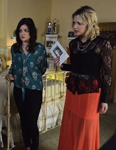 Aria wearing skull blouse and Hanna wearing black lace top with skirt