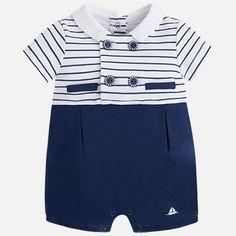 Baby boy dressing baby