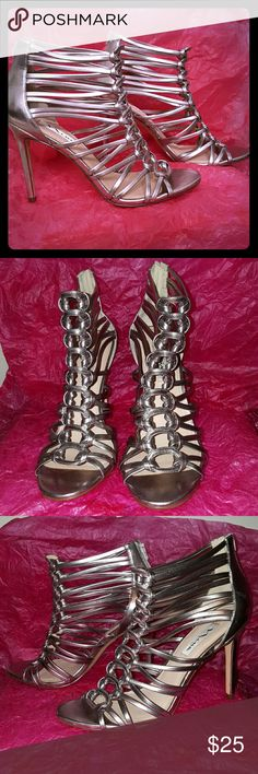 """Nina Silvana caged metallic 39/9 Caylani Get ready for the night out! Bold metallic faux leather upper. Leather sole. 4 1/4"""" covered slim heel. Back zipper closure. Padded footbed. Left heel has a slight scubbing, see last pic. Production sample. Nina Shoes Sandals"""