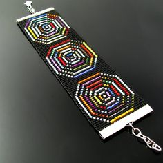 I love to play with lots of colors on a black background. The pattern in this bracelet (designed by me as all of my patterns) is truly hypnotizing if you look at it for a while. Although I didn't m...