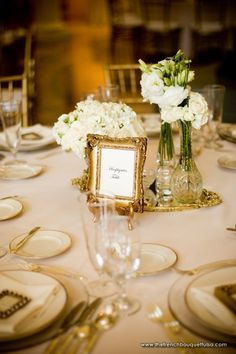 Small Centerpiece Clusters of White Roses and Lisianthus