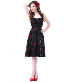Picked fresh, just for you. A fabulous black swing dress, complete with a Red Tulip motif throughout. Pleating at the na...Price - $79.00 A dress with a little va-va voom for a date night.