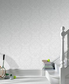 White damask wallpaper.  Love the subtlety of the tone-on-tone.