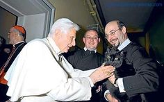 """Pope Benedict XVI-Cardinal Roger Mahony, archbishop of Los Angeles, who was in Rome for the pope's inauguration, says """"The street talk that the pope loves cats is incorrect. The pope adores cats."""""""