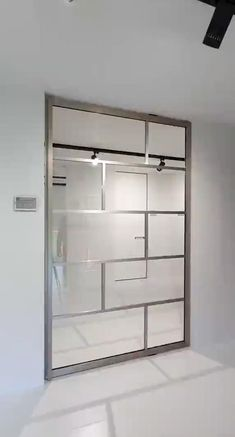 """Glass pivot door finished in a very special """"stainless steel"""" anodized aluminium. The pivot hinge is fully intergrated inside the door! There's nothing that needs to be installed in advance criativas sala com espelho Glass pivot door stainless steel Room Divider Doors, Office Room Dividers, Office Doors, Pivot Doors, Entry Doors, Sliding Shower Doors, Bathroom Doors, Barn Doors, Glass Partition"""