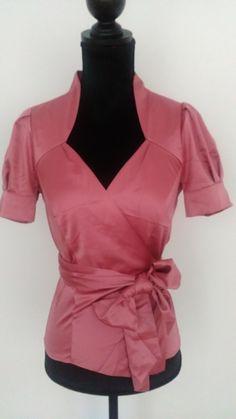 chemisier cachecoeur rose benetton en soie  manche courtes un peu ballon  beau décolleté