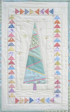 love the non-Christmasy tree. Could be hung all year long. PDF pattern for sale.