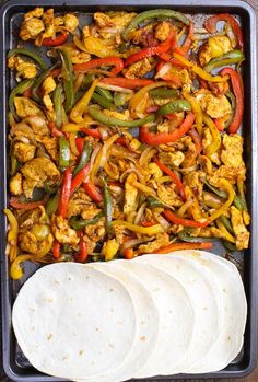 Sheet Pan Chicken Fajita – one of the easiest healthy dinner recipes. Yellow, red and green peppers, sliced onions and chicken breasts, mixed with some simple spices (ground cumin, chili powder, garlic powder, salt and olive oil). Perfectly baked in the oven, and served on flour tortillas. Simply Yummy! Make-ahead recipe. Quick and easy dinner recipe. | tipbuzz.com #ChickenFajitas #sheetPanChickenFajitas