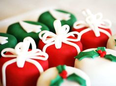 Christmas Petite Fours that look like gifts and have a fondant gift tag attached - place cards that double as dessert