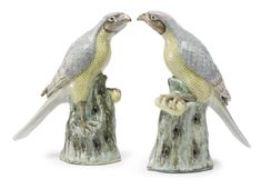 A PAIR OF CHINESE EXPORT PORCELAIN FAMILLE-ROSE FIGURES OF HAWKS - 19TH CENTURY -   height 12 in., 30.5 cm
