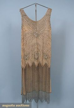 "BEADED FLAPPER DRESS Pale apricot chiffon beaded allover w/ floral motif in rhinestones & iridescent beads, skirt w/ 20"" silver bugle bead fringe"