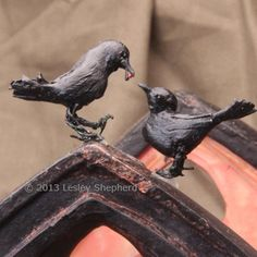 You can make your own miniature crows or ravens for Halloween scenes using paper mache or air dry clay