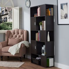 This alternating paneled bookcase provides an open view of your decorative accessories while hiding more valuable or personal items within the handy covered cabinets. The standalone structure easily doubles as a bookshelf or room divider.