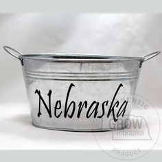 "RCK Creations and More Nebraska Galvanized Tub: This is a great container to load up with Nebraska products for that perfect Nebraska gift. Tub measures 9"" L x 7"" W x 5"" H. Bottom measures 7.5"" x 5"".  #GrowNE www.buynebraska.com/RCK-Creations-and-More-Nebraska-Galvanized-Tub-p/18431.htm"