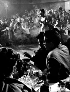 Billie Holliday performing at Cafe Society, NYC's first intergrated nightclub, 1947 - photograph by Gjon Mili.