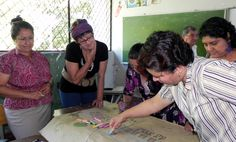 UN Volunteer Rita de Cassia Dutra, second from left, and teachers of the Salvador Hidalgo Cornejo school in Guadalupe, San Vincente, draw up the concept of an ideal school. This is part of the activities of the Disaster Risk Reduction workshop held twice a month in the school with teachers and community members. (Etel Matielo/UNV, 2011)