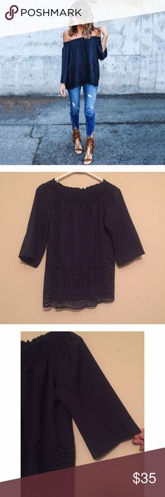 Navy Blue Off the Shoulder Embroidered Top NWOT This quarter sleeved off the shoulder blouse is beautiful & great to pair with jeans or shorts. Last pic shows the design on the bottom. Great statement piece to any outfit. One size fits all. Boutique Tops Blouses